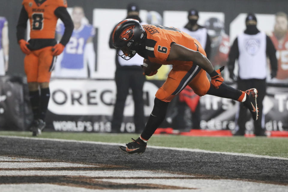Oregon State running back Jermar Jefferson scores a touchdown during the second half of an NCAA college football game against Oregon in Corvallis, Ore., Friday, Nov. 27, 2020. Oregon State won 41-38. (AP Photo/Amanda Loman)