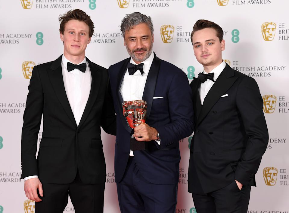 LONDON, ENGLAND - FEBRUARY 02: (L to R) George MacKay, Taika Waititi, winner of the Best Adapted Screenplay award for