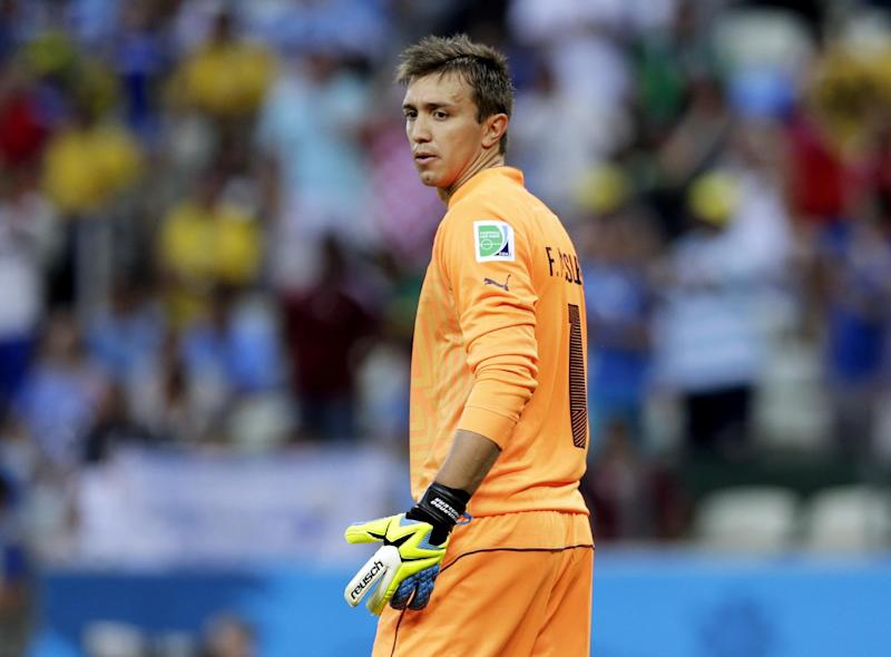 Uruguay's goalkeeper Fernando Muslera looks back after being scored on by Costa Rica's Joel Campbell during the group D World Cup soccer match between Uruguay and Costa Rica at the Arena Castelao in Fortaleza, Brazil, Saturday, June 14, 2014
