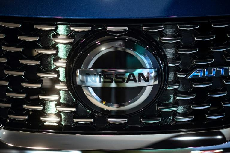 Crisis-hit Japanese automaker Nissan says it has trimmed losses in the second quarter and upgraded its full-year forecasts