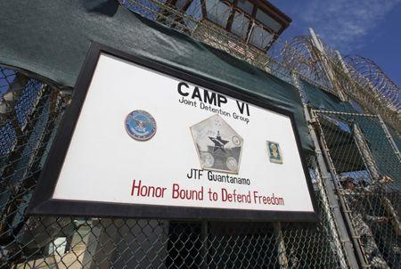 A guard opens the gate at the entrance to Camp VI, a prison used to house detainees at the U.S. Naval Base at Guantanamo Bay in Cuba