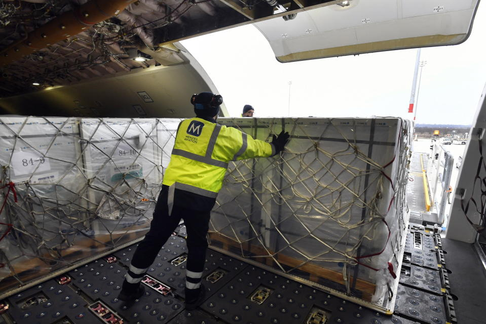 A box containing vaccines is unloaded from a Hungarian Airbus 330 cargo plane as the first batch of the vaccine against the new coronavirus produced by Sinopharm of China arrives at Budapest Liszt Ferenc International Airport in Budapest, Hungary, Tuesday, Feb. 16, 2021. The vaccine will not be used without its examination and approval by the National Public Health Center of Hungary. (Zoltan Mathe/MTI via AP)