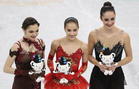 Figure Skating - Pyeongchang 2018 Winter Olympics - Women Single Skating free skating competition final - Gangneung Ice Arena - Gangneung, South Korea - February 23, 2018 - Gold medallist Alina Zagitova, an Olympic Athlete from Russia, silver medallist Evgenia Medvedeva, an Olympic Athlete from Russia, and bronze medallist Kaetlyn Osmond of Canada pose. REUTERS/Lucy Nicholson