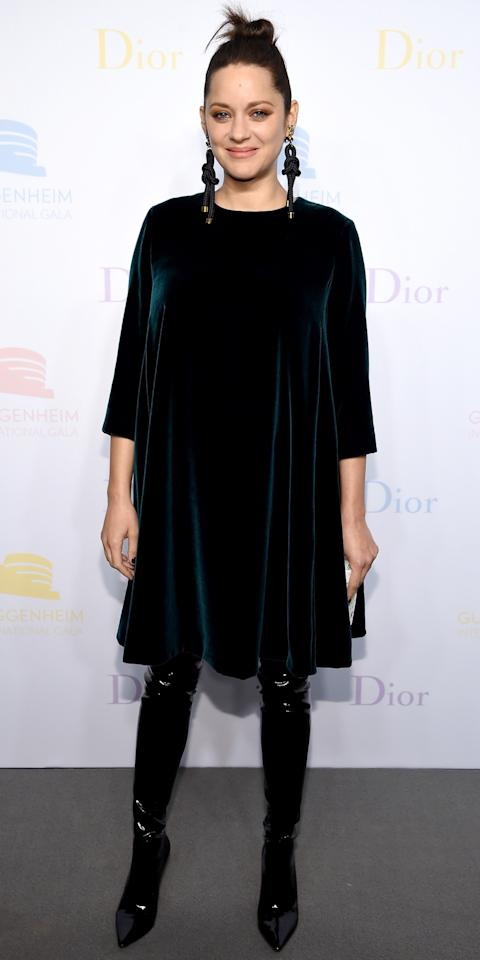 <p>The expectant star wowed at the 2016 Guggenheim International Pre-Party in a wow-worthy velvet Dior dress and black latex thigh-high boots.</p>