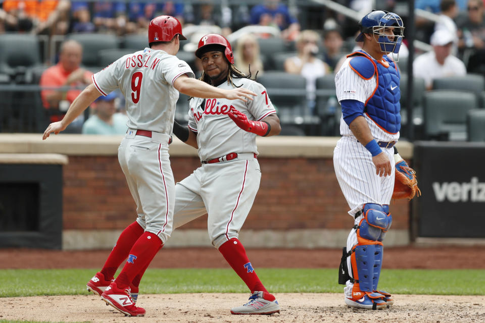 Philadelphia Phillies' Maikel Franco (7) celebrates with the Phillies' Phil Gosselin (9) after hitting a two-run, home run during the sixth inning in a baseball game against the New York Mets, Sunday, Sept. 8, 2019, in New York. Mets' catcher Wilson Ramos (40) is at right. (AP Photo/Kathy Willens)