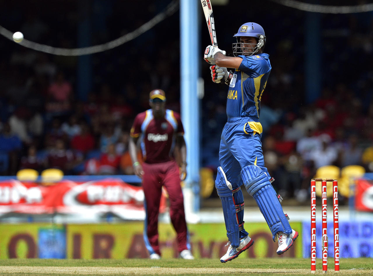 Sri Lankan cricketer Lahiru Thirimanne (R) plays a shot during the fifth match of the Tri-Nation series between Sri Lanka and West Indies at the Queen's Park Oval in Port of Spain on July 7, 2013. West Indies won the toss and elected to field. AFP PHOTO/Jewel Samad        (Photo credit should read JEWEL SAMAD/AFP/Getty Images)