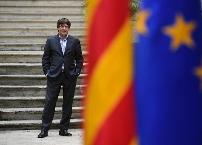 Catalonia's dismissed leader Carles Puigdemont was due to give a press conference in Brussels on Tuesday (AFP Photo/PIERRE-PHILIPPE MARCOU)