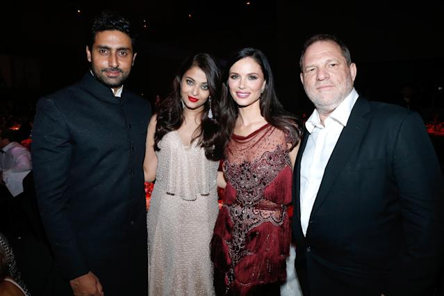 Aishwarya Rai's actor husband, Abhishek Bachchan, and Rai pose with Georgina Chapman and Harvey Weinstein at amfAR's gala during the Cannes Film Festival in 2014. (Photo: Bertrand Rindoff Petroff/amfAR14/WireImage)