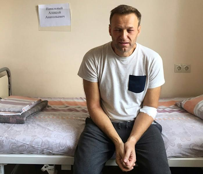 Russian opposition leader Alexei Navalny sitting on a hospital bed in Moscow