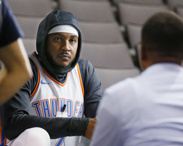 """<a class=""""link rapid-noclick-resp"""" href=""""/nba/players/3706/"""" data-ylk=""""slk:Carmelo Anthony"""">Carmelo Anthony</a>, lost in thought about how he's at least worth a ham sandwich and some onion rings. (AP)"""
