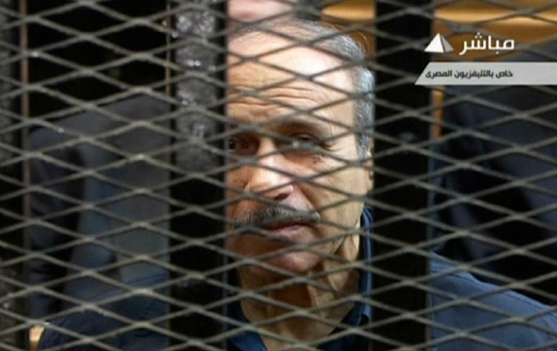 Former Egyptian interior minister Habib al-Adly is seen behind bars during a trial in Cairo in 2013, in an image grab from state TV