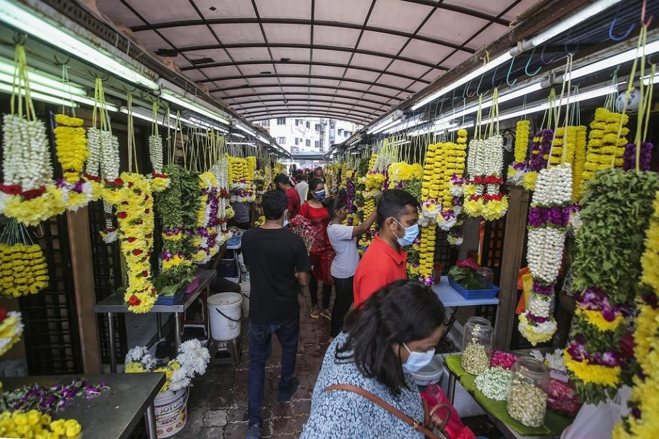 People shop for the upcoming Deepavali celebration in Brickfields November 12, 2020. — Picture by Hari Anggara