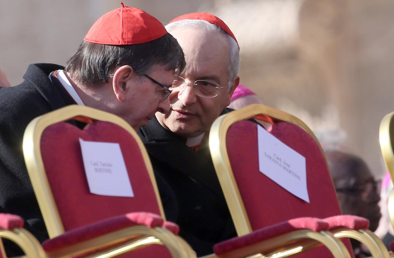 VATICAN CITY, VATICAN - FEBRUARY 27:  Two cardinals chat in St. Peter's Square before Pope Benedict XVI's  final general audience on February 27, 2013 in Vatican City, Vatican. The Pontiff attended his last weekly public audience before stepping down tomorrow. Pope Benedict XVI has been the leader of the Catholic Church for eight years and is the first Pope to retire since 1415. He cites ailing health as his reason for retirement and will spend the rest of his life in solitude away from public engagements.  (Photo by Franco Origlia/Getty Images)
