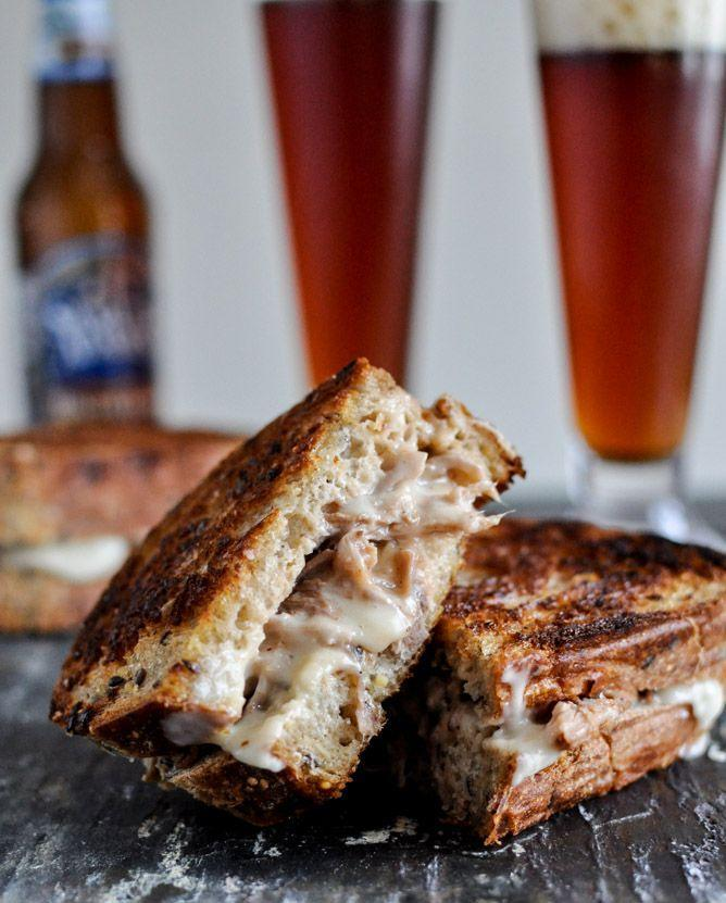 """<p>Every game day should include a grilled cheese situation, and this pulled pork option is your best bet. </p><p><a href=""""http://www.howsweeteats.com/2012/12/crockpot-pulled-pork-beer-cheese-grilled-cheese-sandwiches/"""" rel=""""nofollow noopener"""" target=""""_blank"""" data-ylk=""""slk:Get the recipe from How Sweet It Is »"""" class=""""link rapid-noclick-resp""""><em>Get the recipe from How Sweet It Is »</em></a><br></p>"""