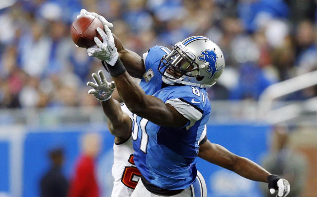 Detroit Lions wide receiver Calvin Johnson (81), defended by Tampa Bay Buccaneers cornerback Johnthan Banks, catches a 21-yard reception during the third quarter of an NFL football game at Ford Field in Detroit, Sunday, Nov. 24, 2013. (AP Photo/Rick Osentoski)
