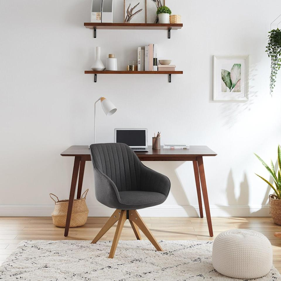 """<h3>Most Wanted Office Chairs </h3><br><h2>Corrigan Studio Swivel Chair </h2><br><strong>Deal: 15% off</strong><br>This most wanted seat is the perfect wheel-less desk chair option to blend from office to living room piece. We live for its modern design, versatility, and comfy tufted cushions. <br><br><em>Shop</em> <strong><em><a href=""""https://www.wayfair.com/furniture/pdp/corrigan-studio-brister-2283-wide-swivel-armchair-w001809980.html"""" rel=""""nofollow noopener"""" target=""""_blank"""" data-ylk=""""slk:Corrigan Studio"""" class=""""link rapid-noclick-resp"""">Corrigan Studio</a></em></strong><br><br><strong>Corrigan Studio</strong> Brister 22.83"""" W Swivel Side Chair, $, available at <a href=""""https://go.skimresources.com/?id=30283X879131&url=https%3A%2F%2Fwww.wayfair.com%2Ffurniture%2Fpdp%2Fcorrigan-studio-brister-2283-w-swivel-side-chair-w001809980.html"""" rel=""""nofollow noopener"""" target=""""_blank"""" data-ylk=""""slk:Wayfair"""" class=""""link rapid-noclick-resp"""">Wayfair</a>"""