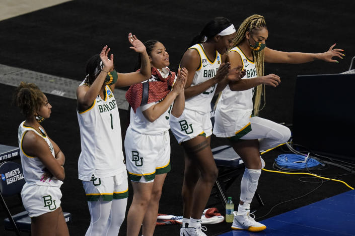 Baylor players celebrate on the bench during the second half of a college basketball game against Jackson State in the first round of the women's NCAA tournament at the Alamodome, Sunday, March 21, 2021, in San Antonio. Baylor won 101-52. (AP Photo/Eric Gay)