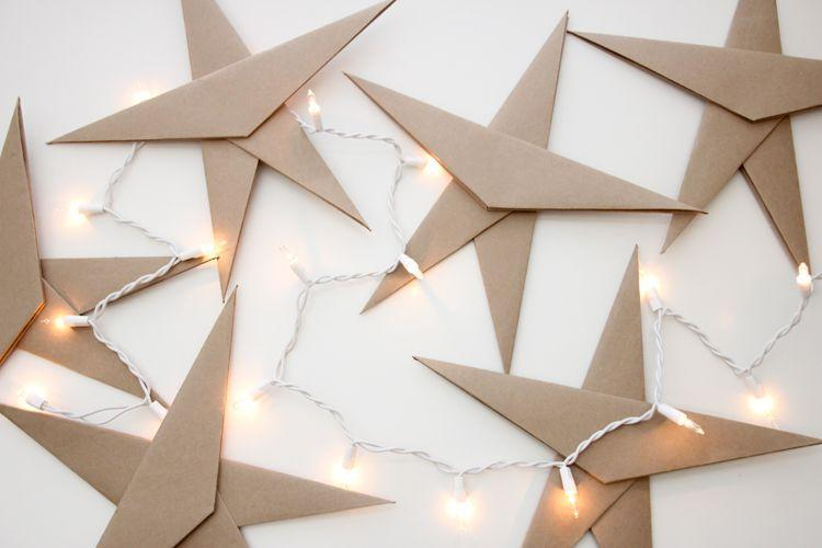 """<p>If you can fold paper, you can make these sleek and sophisticated DIY ornaments. </p><p><em>Get the tutorial at <a href=""""https://www.deliacreates.com/almost-origami-ornament-stars-3/"""" rel=""""nofollow noopener"""" target=""""_blank"""" data-ylk=""""slk:Delia Creates"""" class=""""link rapid-noclick-resp"""">Delia Creates</a>. </em></p><p><a class=""""link rapid-noclick-resp"""" href=""""https://www.amazon.com/Paper-Bag-Kraft-Recycled-Cardstock/dp/B01KWU4ZI0?tag=syn-yahoo-20&ascsubtag=%5Bartid%7C10072.g.34443405%5Bsrc%7Cyahoo-us"""" rel=""""nofollow noopener"""" target=""""_blank"""" data-ylk=""""slk:SHOP KRAFT PAPER"""">SHOP KRAFT PAPER</a></p>"""