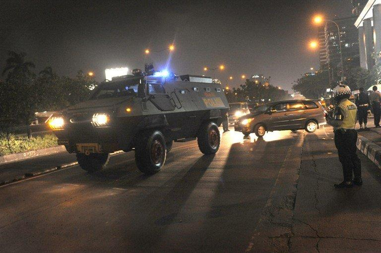 A police armored vehicle escorts a prisoner in Jakarta on June 21, 2012