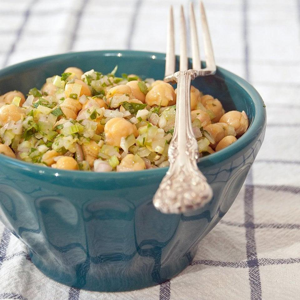 """<p><strong>Get the recipe:</strong> <a href=""""http://www.popsugar.com/food/Marinated-Chickpea-Salad-29309397/"""" class=""""link rapid-noclick-resp"""" rel=""""nofollow noopener"""" target=""""_blank"""" data-ylk=""""slk:marinated chickpea salad"""">marinated chickpea salad</a><br> <strong>Cans needed:</strong> chickpeas</p>"""