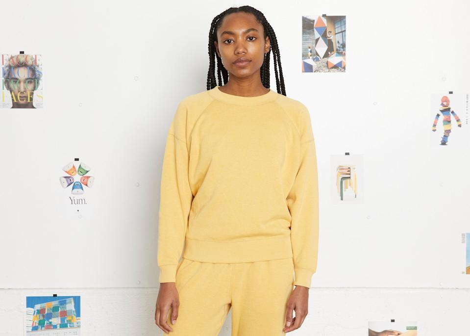 """<br><br><strong>Entireworld</strong> Loop Back Sweatshirt - Mimosa Yellow, $, available at <a href=""""https://go.skimresources.com/?id=30283X879131&url=https%3A%2F%2Ftheentireworld.com%2Fwomen%2Fproduct%2Fsweatshirt-womens-type-a-version-3-mimosa-yellow"""" rel=""""nofollow noopener"""" target=""""_blank"""" data-ylk=""""slk:Entireworld"""" class=""""link rapid-noclick-resp"""">Entireworld</a>"""