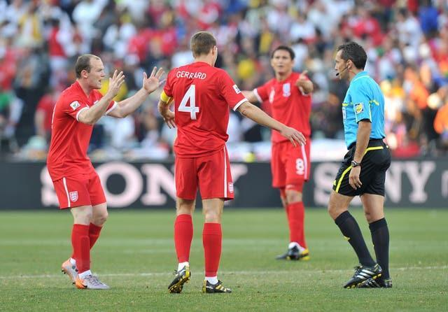 Wayne Rooney (left) and Steven Gerrard (centre) argue with the referee Jorge Larrionda (right) after Lampard's goal was ruled out