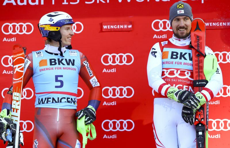 Austria's Marcel Hirscher, right, winner of an alpine ski, men's World Cup slalom, is flanked on the podium by second placed Norway's Henrik Kristoffersen, in Wengen, Switzerland, Sunday, Jan. 14, 2018. (AP Photo/Alessandro Trovati)
