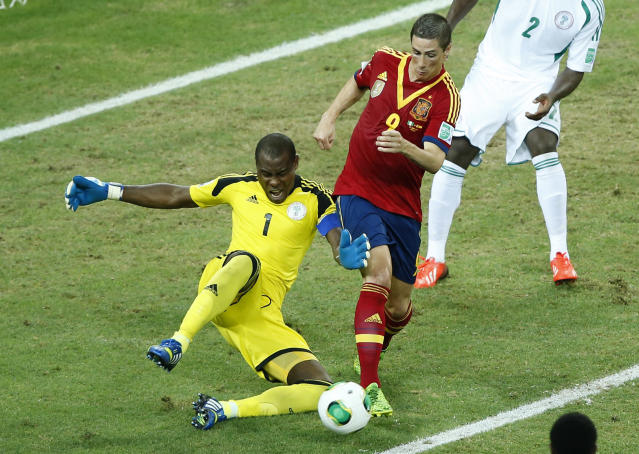 FILE - In this June 23, 2013, file photo, Nigeria goalkeeper Vincent Enyeama, left, challenges Spain's Fernando Torres during the soccer Confederations Cup group B match between Nigeria and Spain at the Castelao stadium in Fortaleza, Brazil. After impressing on their way to the second round in each of their first two FIFA World Cup appearances, 1994 and 1998, Nigeria have struggled since: going out at the group stage three times while taking just two points from their last eight matches in the finals. (AP Photo/Victor R. Caivano,File)
