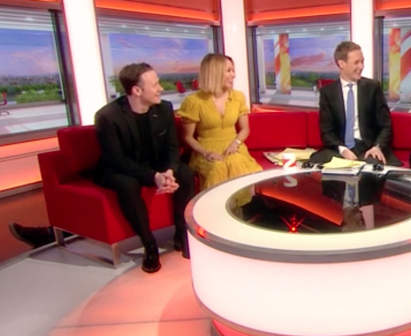 Viewers spotted Tracey's foot slip out from behind the couch. Photo: BBC Breakfast