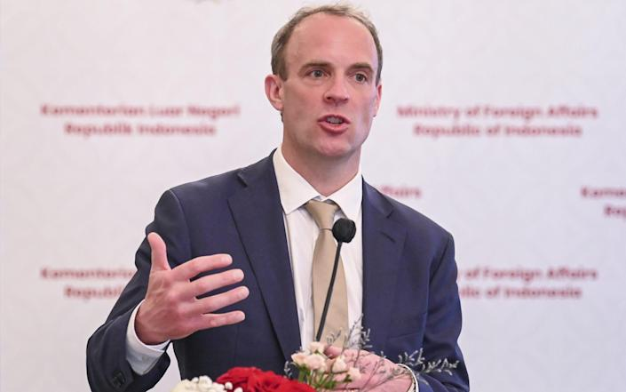 """Dominic Raab said the UK would """"call out Russia's malign behaviour"""" - EPA"""