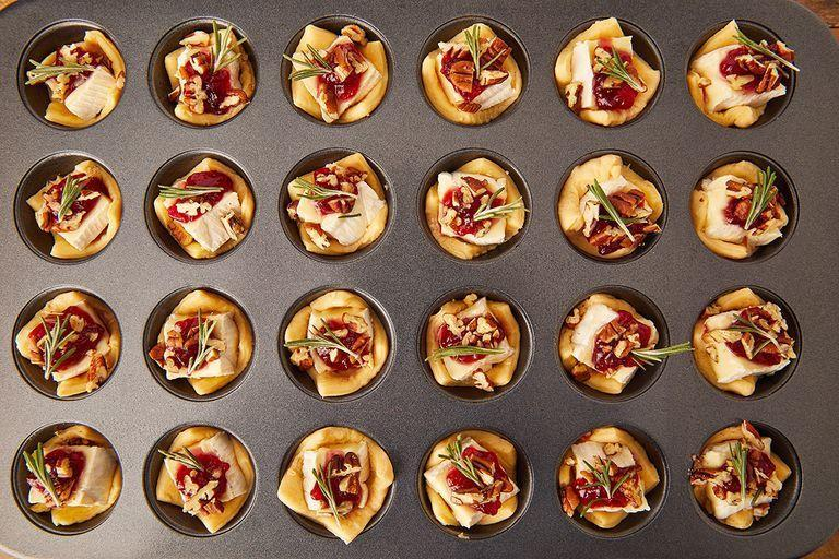 """<p>These little guys are the perfect appetiser. Be warned: It'll forever change the way you think about brie. </p><p>Get the <a href=""""https://www.delish.com/uk/cooking/recipes/a29664090/cranberry-brie-bites-recipe/"""" rel=""""nofollow noopener"""" target=""""_blank"""" data-ylk=""""slk:Cranberry Brie Bites"""" class=""""link rapid-noclick-resp"""">Cranberry Brie Bites</a> recipe.</p>"""