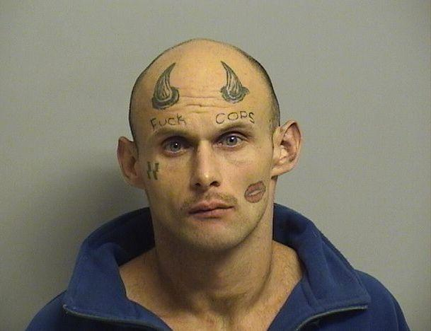 """When police picked up Paul Terry earlier this month on armed robbery charges, they were able to do so based on a very specific description by the victim. It seems the 26-year-old suspect had <a href=""""http://www.huffingtonpost.com/entry/armed-robbery-suspect-paul-terry-mugshot-of-the-year_5678523ae4b014efe0d6401b"""" target=""""_blank"""">some very distinctive tattoos</a> that included some strong opinions of law enforcement officials."""