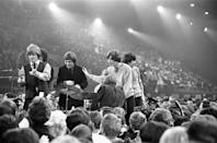 <p>Mick Jagger and the Rolling Stones take the stage for their performance during a music show that lasted from 9 p.m. to 7 a.m. and was hosted by Jimmy Savile, 1964.</p>