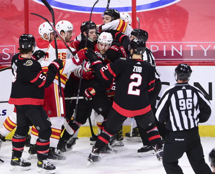 Tempers fly between the Ottawa Senators and the Calgary Flames during second period NHL hockey action in Ottawa on Monday, March 1, 2021. (Sean Kilpatrick/The Canadian Press via AP)