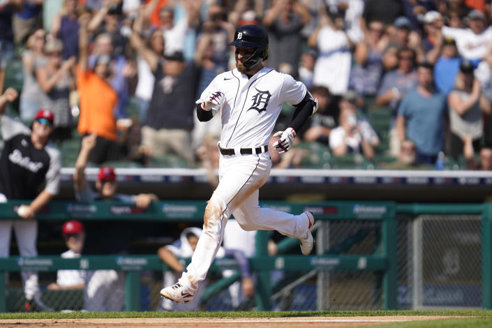 Detroit Tigers' Eric Haase, right, rounds third base on his three run inside-the-park home run in the fourth inning of a baseball game against the Chicago White Sox in Detroit, Saturday, July 3, 2021. (AP Photo/Paul Sancya)