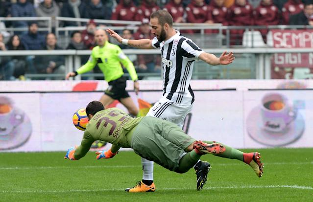 Soccer Football - Serie A - Torino vs Juventus - Stadio Olimpico Grande Torino, Turin, Italy - February 18, 2018 Juventus' Gonzalo Higuain sustains an injury after colliding with Torino's Salvatore Sirigu REUTERS/Massimo Pinca