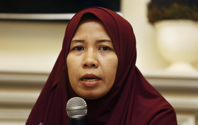 Merdian Agustin family of a victim of the Lion Air jet that crashed into the Java Sea talks to journalists during a press conference in Jakarta, Monday, April 8, 2019. More families of victims of the Lion Air crash in Indonesia are suing Boeing Co. after its chief executive apologized last week and said a software update for the MAX 8 jet would prevent further disasters. (AP Photo/Achmad Ibrahim)