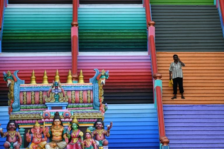 The newly-painted 272-steps staircase at Batu Caves is part of an important religious site for Tamil Hindus