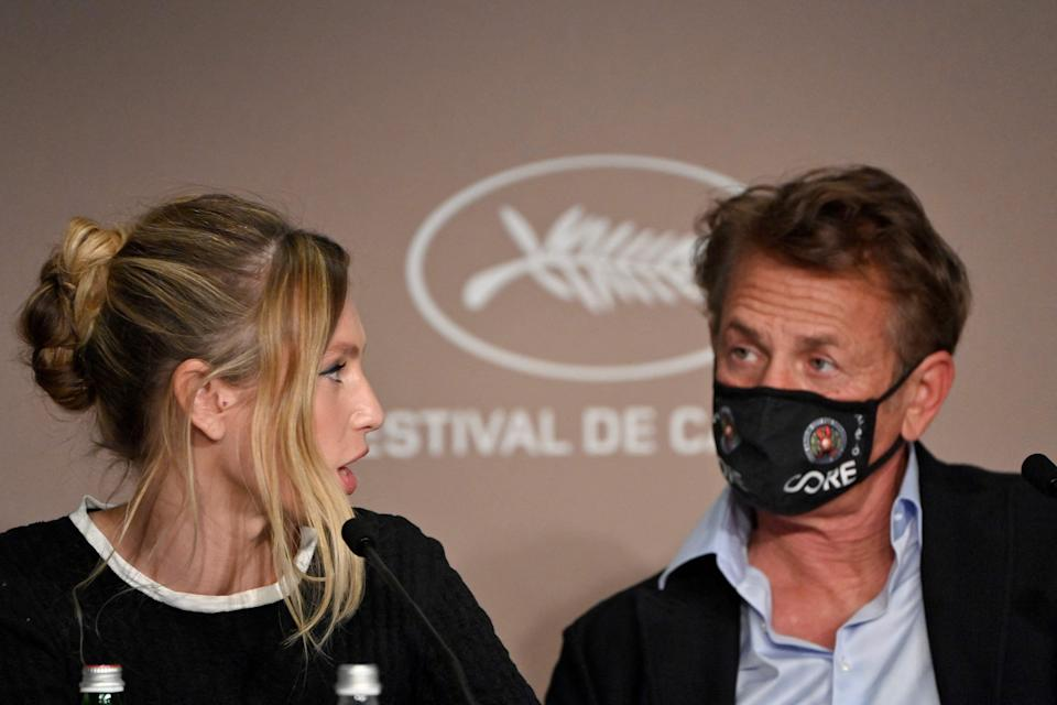 """Dylan Penn, left, and father Sean Penn during a news conference for """"Flag Day"""" at Cannes Film Festival."""