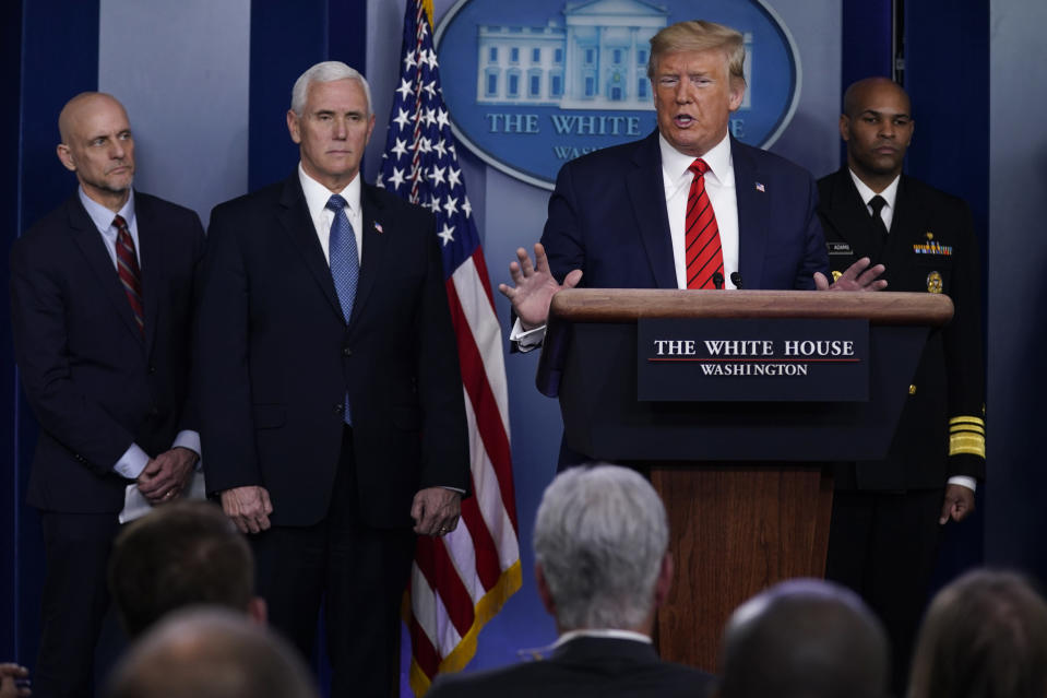President Donald Trump speaks during press briefing with the coronavirus task force, at the White House, Thursday, March 19, 2020, in Washington. From left, Food and Drug Administration Commissioner Dr. Stephen Hahn, Vice President Mike Pence, Trump, and Surgeon General Jerome Adams. (AP Photo/Evan Vucci)