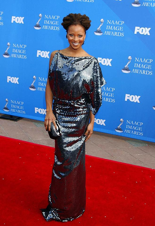 """America's Next Top Model"" winner Eva Pigford strikes a fierce pose in a shimmery sequined dress. Jeffrey Mayer/<a href=""http://www.wireimage.com"" target=""new"">WireImage.com</a> - February 13, 2008"