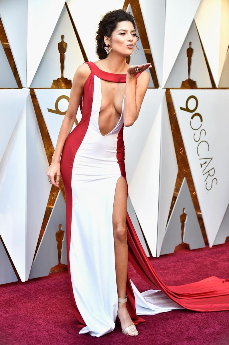 Blanca's gown barely stayed in place as she worked the red carpet. Photo: Getty