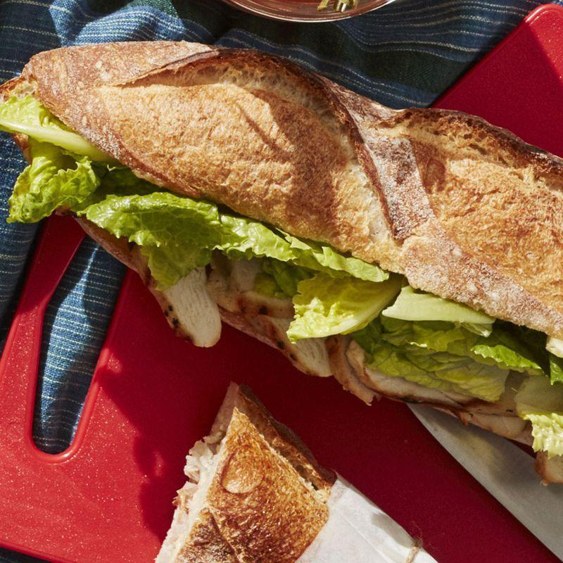 """<p>At just 235 calories per serving, you can make this baguette ahead of time and serve it at dinner time.</p><p><u><em><a href=""""https://www.womansday.com/food-recipes/food-drinks/a27496244/grilled-chicken-caesar-baguette-recipe/"""" rel=""""nofollow noopener"""" target=""""_blank"""" data-ylk=""""slk:Get the recipe for Grilled Chicken Caesar Baguette."""" class=""""link rapid-noclick-resp"""">Get the recipe for Grilled Chicken Caesar Baguette.</a></em></u></p>"""