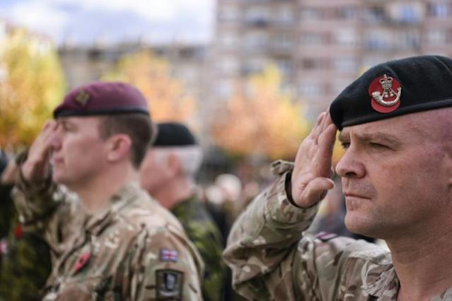 British soldiers serving in a NATO-led international peacekeeping mission in Kosovo salute as they take part in a ceremony in Pristina (AFP Photo/Armend NIMANI)