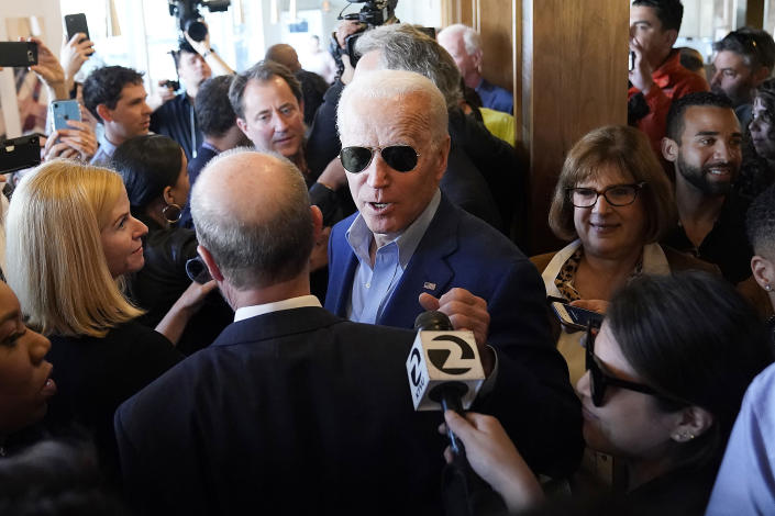Democratic presidential candidate former Vice President Joe Biden greets customers at the Buttercup Diner during a campaign stop in Oakland, Calif., Tuesday, March 3, 2020. (AP Photo/Tony Avelar)