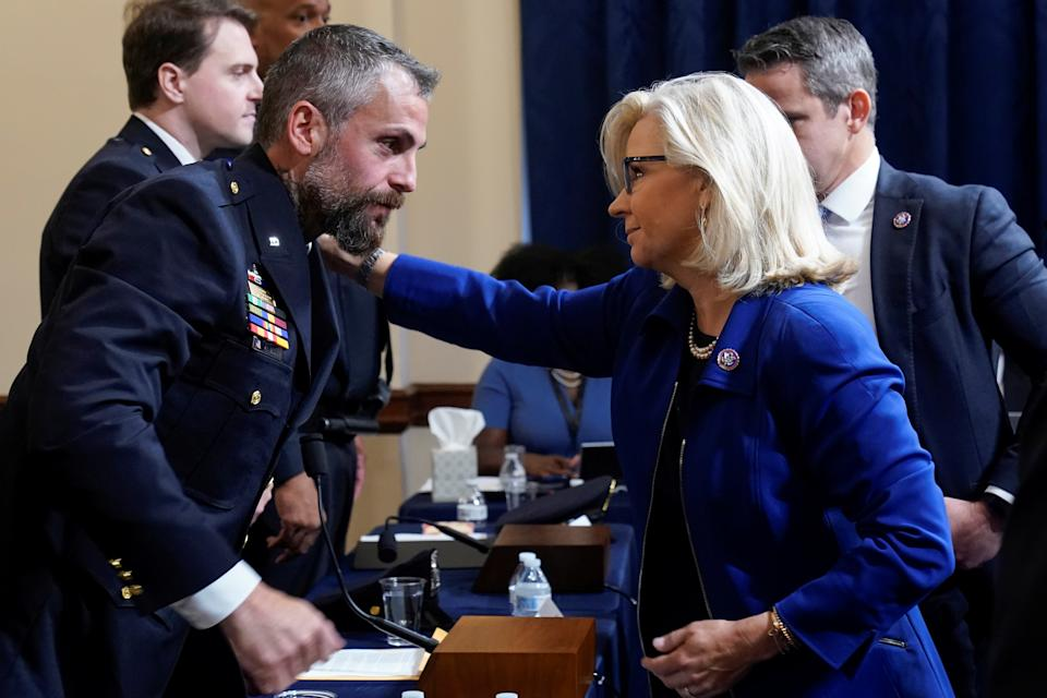 U.S. Rep. Liz Cheney, R-Wyo., greets Washington Metropolitan Police Department officer Michael Fanone before the first House select committee hearing on the Jan. 6 attack on Capitol Hill in Washington, U.S., July 27, 2021.  (Andrew Harnik/Reuters)