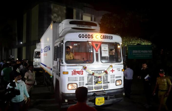 Trucks carrying first consignment of COVISHIELD leave from Serum Bio-Pharma Park of Serum Institute of India, for its distribution, in Pune
