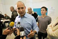 Naftali Bennett, head of the Israeli hardline national religious party Jewish Home, speaks to the media after voting in a polling station in Raanana, central Israel, on January 22, 2013