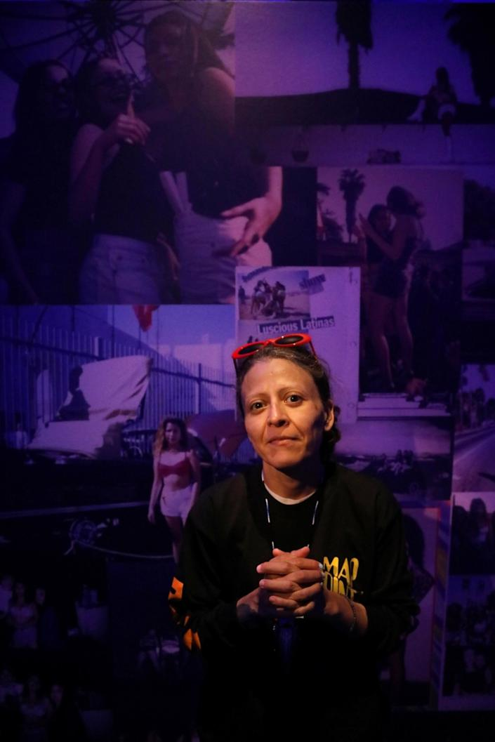 "Artist Guadalupe Rosales stands inside her exhibit at the Vincent Price Art Museum in in 2018. <span class=""copyright"">(Genaro Molina / Los Angeles Times)</span>"