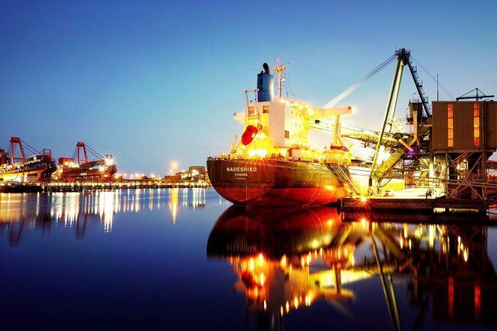A long-exposure photo of a ship being loaded at the Port Kembla Grain Terminal in New South Wales.